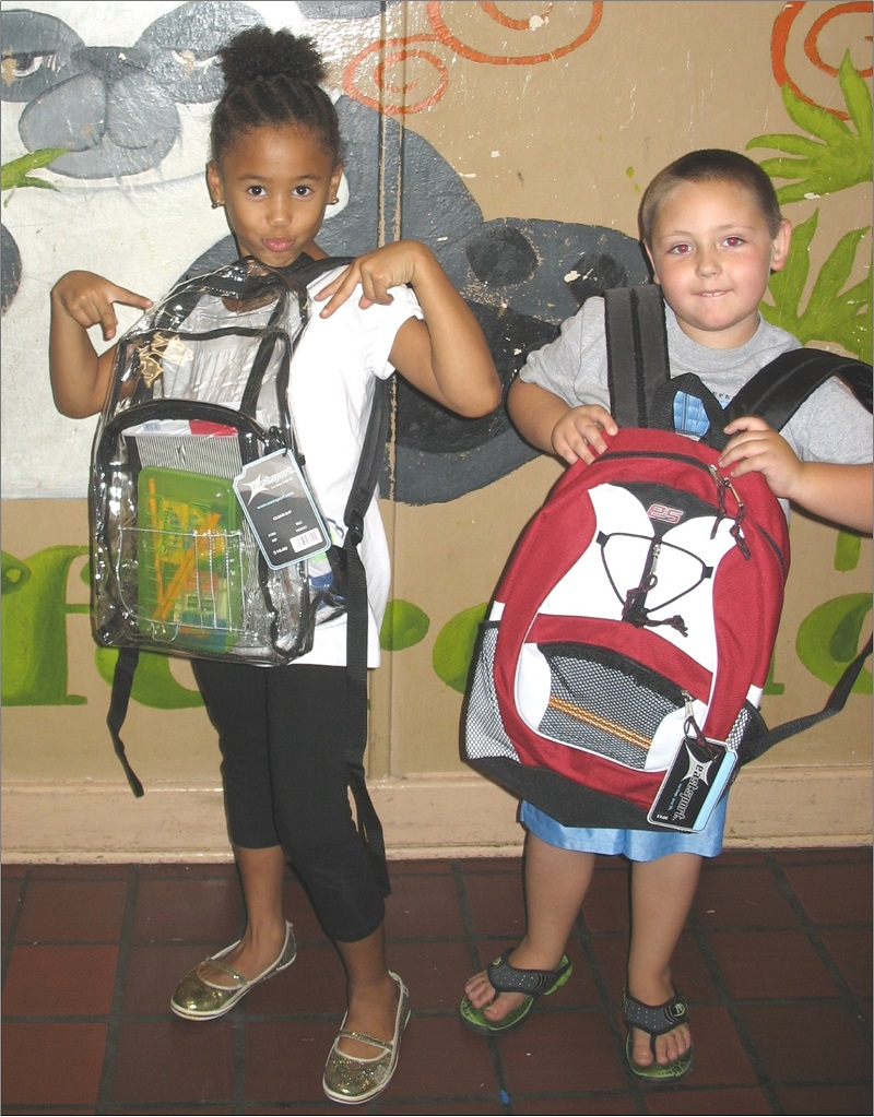 Children with new backpacks.