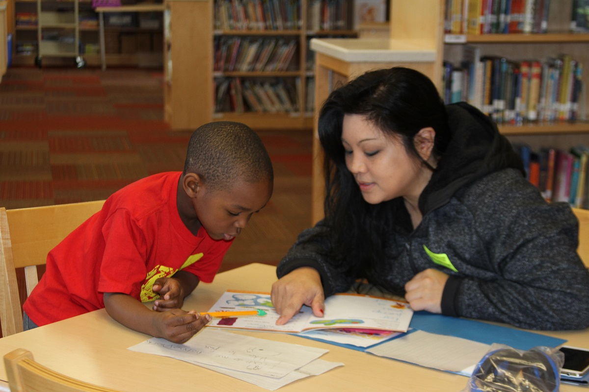 New Life Church member and child at LEC's College Park Elementary program